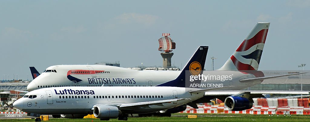 A Lufthansa (Foreground) and British Airways passenger jets taxi onto the runway before taking off from Heathrow Airport on May 24, 2010. AFP PHOTO/Adrian Dennis
