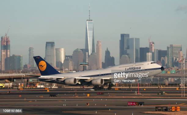 Lufthansa Boeing 747 airplane passes by the skyline of lower Manhattan in New York City as it lands at Newark Liberty Airport on January 21 2019 in...