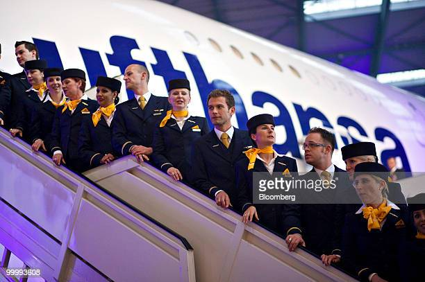 Lufthansa cabin attendants stand for a picture in front of the first Lufthansa Airbus A380 airplane in Frankfurt Germany on Wednesday May 19 2010...