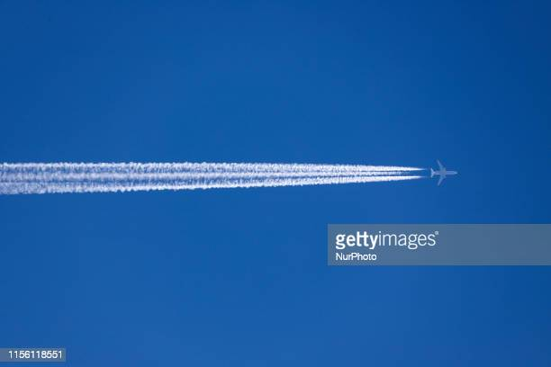 Lufthansa Cargo McDonnell Douglas MD11 airplane overflying forming engine exhaust contrails behind in high altitude The iconic triple engine MD11 Jet...