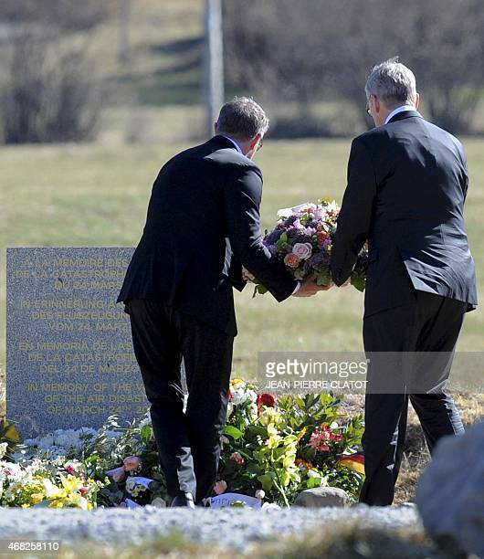 Lufthansa CEO Carsten Spohr and Germanwings CEO Thomas Winkelmann lay a wreath near a stele in memory of the victims of the Germanwings Airbus A320...