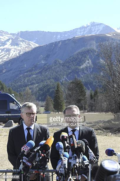 Lufthansa CEO Carsten Spohr and Germanwings CEO Thomas Winkelmann speaks to the press after laying a wreath near a stele in memory of the victims of...
