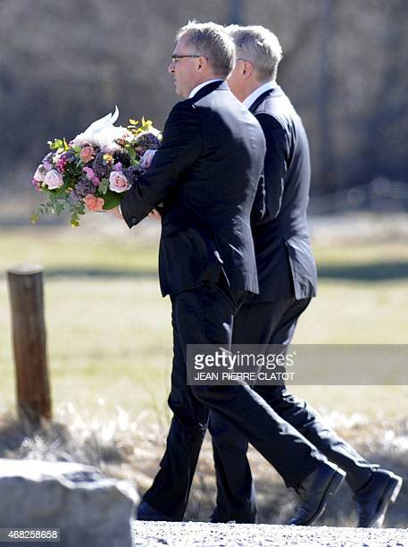 Lufthansa CEO Carsten Spohr and Germanwings CEO Thomas Winkelmann arrive to lay a wreath near a stele in memory of the victims of the Germanwings...