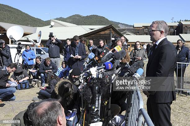 Lufthansa CEO Carsten Spohr speaks to the press after laying a wreath near a stele in memory of the victims of the Germanwings Airbus A320 crash in...