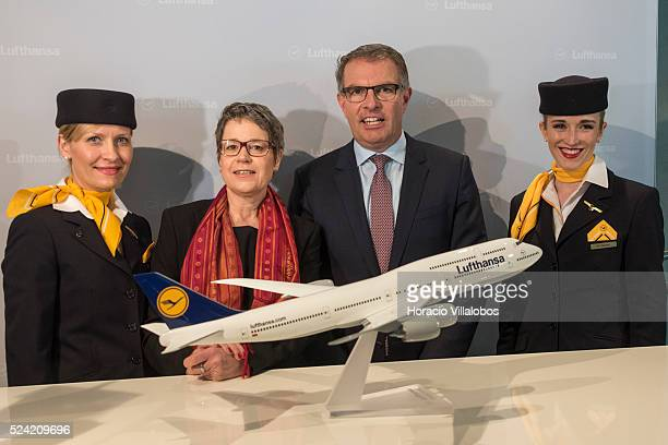 Lufthansa CFO Simone Menne and CEO Carsten Spoor pose for photographers during their press conference in which the group Full Year 2014 results were...