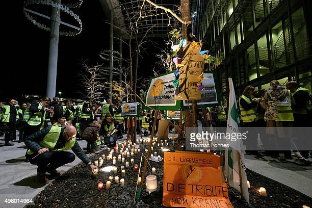 Lufthansa flight crew members put candles and banners in front of the 'Lufthansa Aviation Center' at Frankfurt Airport during an initial strike over...