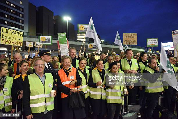 Lufthansa flight crew members stand at Frankfurt Airport during an initial strike over salaries at Frankfurt and Dusseldorf airports on November 6...