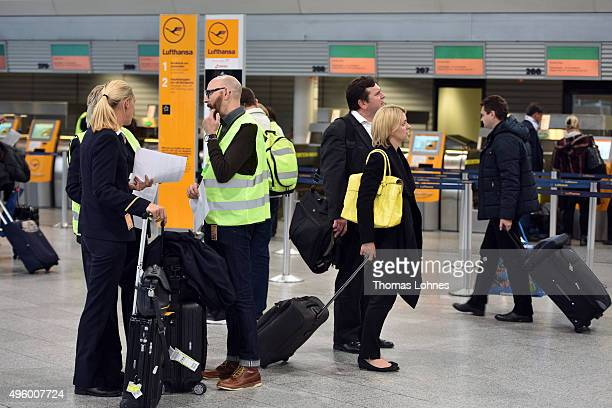 Lufthansa flight crew members stand at terminal 1at Frankfurt Airport during an initial oneday strike over salaries at Frankfurt and Dusseldorf...