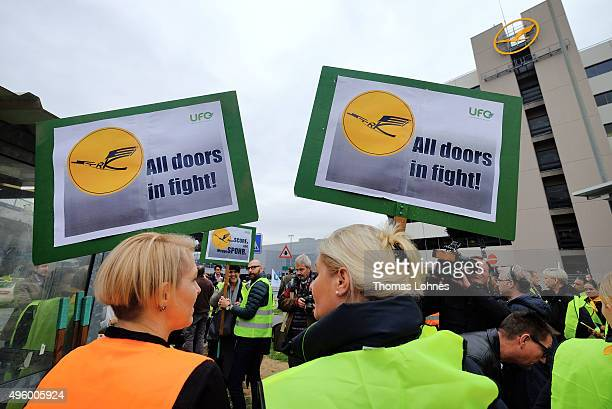 Lufthansa flight crew members stand outside the main terminal building at Frankfurt Airport during an initial oneday strike over salaries at...
