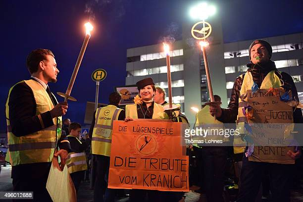 Lufthansa flight crew members stand with torches and candles at Frankfurt Airport during an initial strike over salaries at Frankfurt and Dusseldorf...
