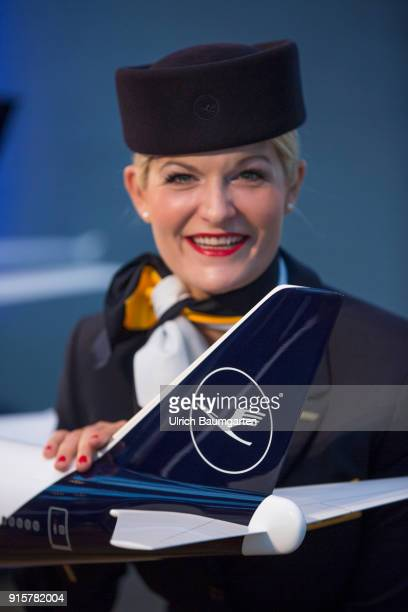 Lufthansa Group event to present the new blue livery on an Lufthansa Jumbo 7478 at Frankfurt Airport Stewardess at the taifin of an airplan model...