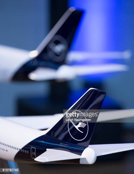 Lufthansa Group event to present the new blue livery on an Lufthansa Jumbo 7478 at Frankfurt Airport Tailfins of airplan models with Lufthansa logo...