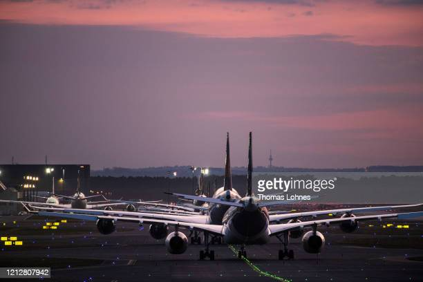 Lufthansa passenger airplanes are lined up at Frankfurt Airport, operated by Fraport AG as airlines are affected by travel bans related to the spread...