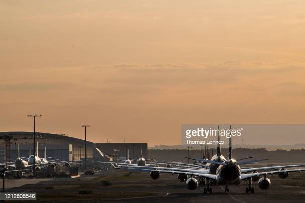 Lufthansa passenger airplanes are lined up at Frankfurt Airport operated by Fraport AG as airlines are affected by travel bans related to the spread...