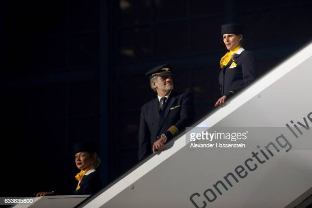 Lufthansa pilot stand next to Lufthansa airhostesses during a rollout event at Munich Airport on February 2 2017 in Munich Germany The Airbus A350...
