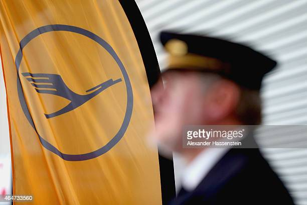 Lufthansa pilote wait during a presentation of the new plane by Airbus officials on February 27 2015 in Munich Germany The A350 is a longdistance...