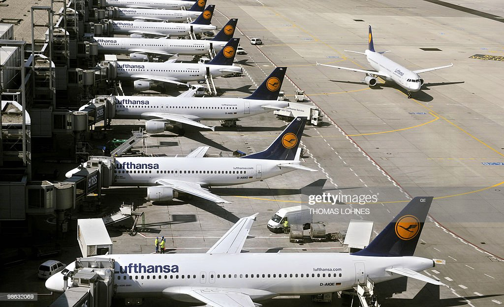 A Lufthansa plane rolls to its parking position past other planes at Frankfurt international airport on April 23, 2010 in Frankfurt am Main. The days of disruption caused by the volcanic ash cloud will dampen the German economy, Europe's largest, but should not harm the country's growth figures, Economy Minister Rainer Bruederle said the day before.
