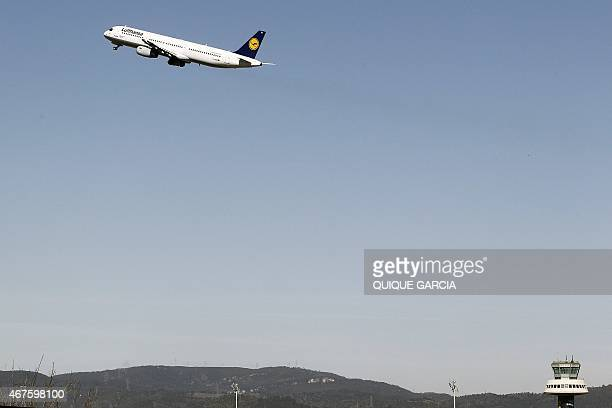 A Lufthansa plane takes off at Barcelona's El Prat Airport transporting relatives of the crashed Germanwings plane victims on March 26 2015 in El...