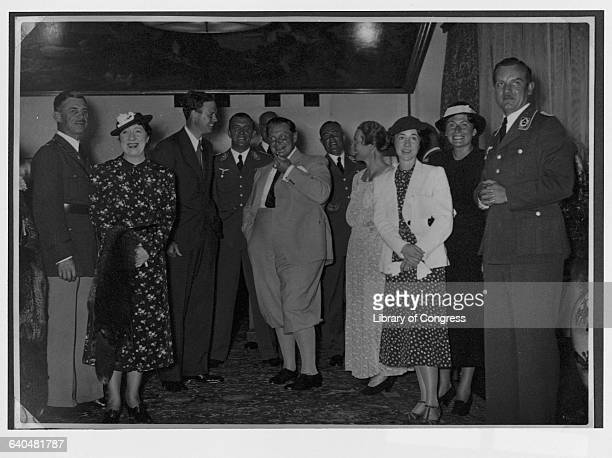 Luftwaffe commander Hermann Goering stands with Charles Lindbergh at a reception during the American aviator's visit to Nazi Germany; his wife Anne...