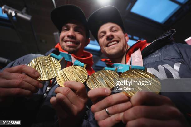Luge doubles olympic champions Tobias Wendl and Tobias Arlt pose with their gold medals during the welcome ceremony for the members of Team Germany...