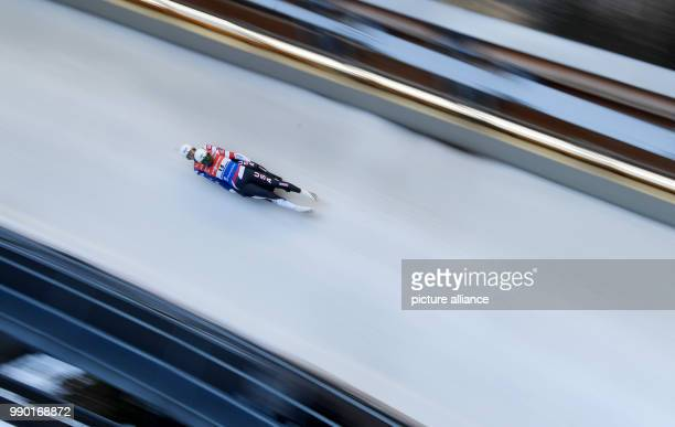 Luge duo in action during the men's doubles event of the Luge World Cup 2018 in Schonau am Konigssee in Germany, 06 January 2018. Photo: Tobias...