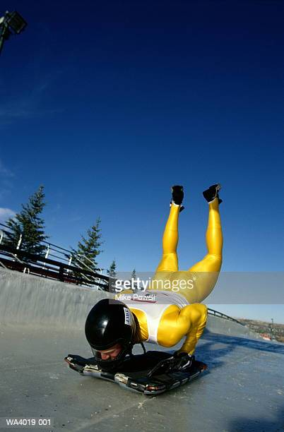 Luge, man doing push-ups on track