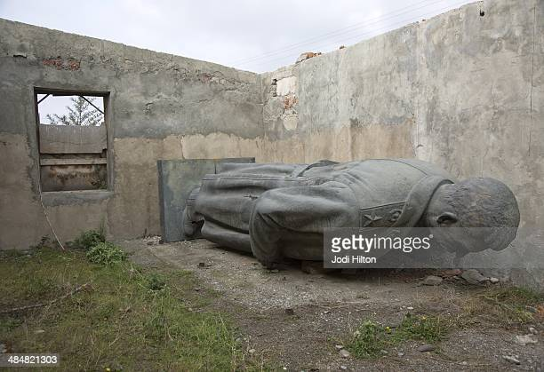 Winter Games Preview View of Joseph Stalin statue in an abandoned building on the outskirts of his hometown The Stalin statue was removed from the...