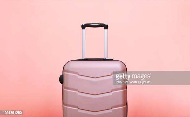 luggage against pink background - suitcase stock pictures, royalty-free photos & images