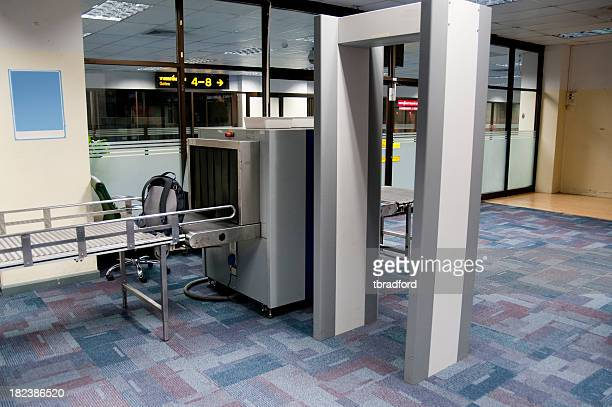 luggage and body scanner in an airport security check point - security check stock photos and pictures