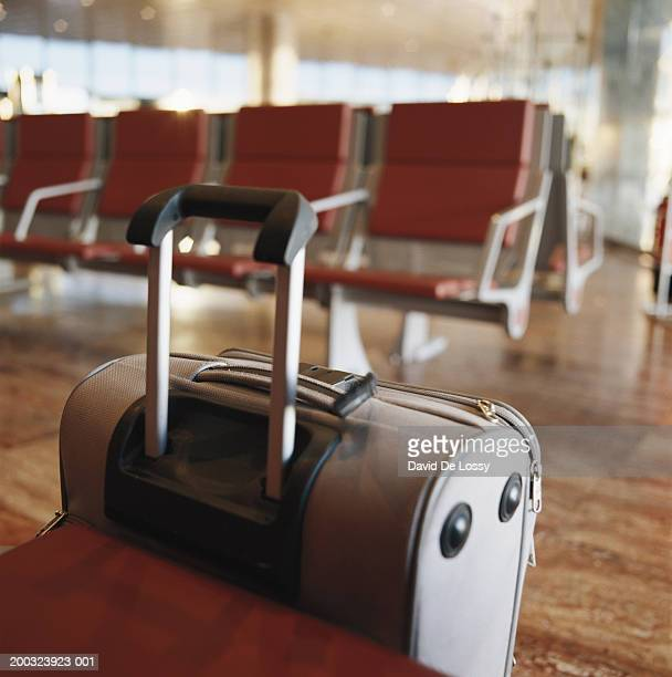 Luggage at empty waiting room in airport