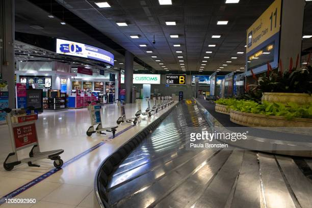 A luggage claim area is seen vacant of any passengers at Suvarnabhumi International airport on March 04 2020 in Bangkok Thailand With limited...