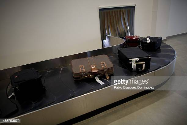 Luggage from passengers of the first commercial flight landing at Castellon airport lay on the baggage carousel on September 15 2015 near Castellon...