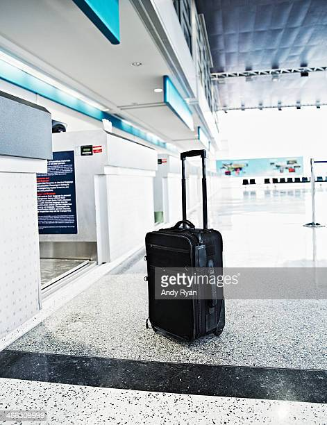 Luggage in airport at check-in counter.