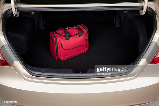 Luggage in Car Trunk
