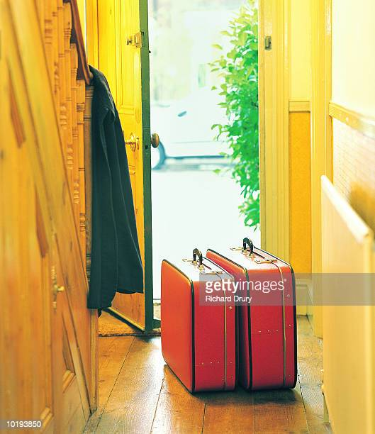 Luggage in hallway by open door