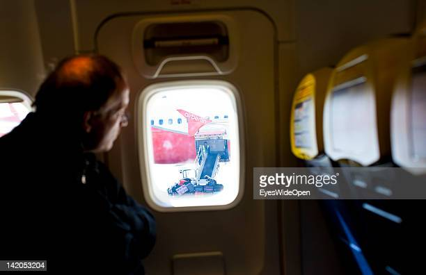 Luggage is unloaded at Alicante Airport off a Air Berlin passenger jet at the gate on February 18 2012 in Alicante Spain