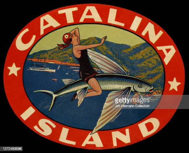 Luggage label for Catalina Island shows an illustration of a woman in a bathing suit sitting atop a fish which is flying through the air above the...