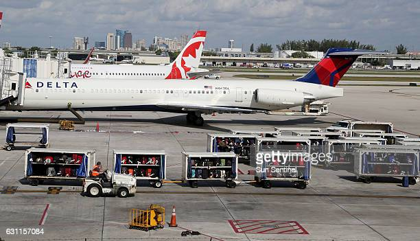 Luggage lined up on the tarmac at Terminal 2 after Fort Lauderdale International Airport reopened on Saturday Jan 7 a day after a shooting in the...