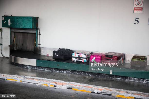 Luggage moves along a luggage carousel at Chiang Mai International Airport in Chiang Mai Thailand on Wednesday Dec 13 2017 Qatar Airways launched its...
