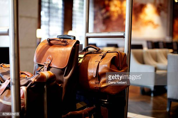 Luggage on a bell cart in a hotel lobby