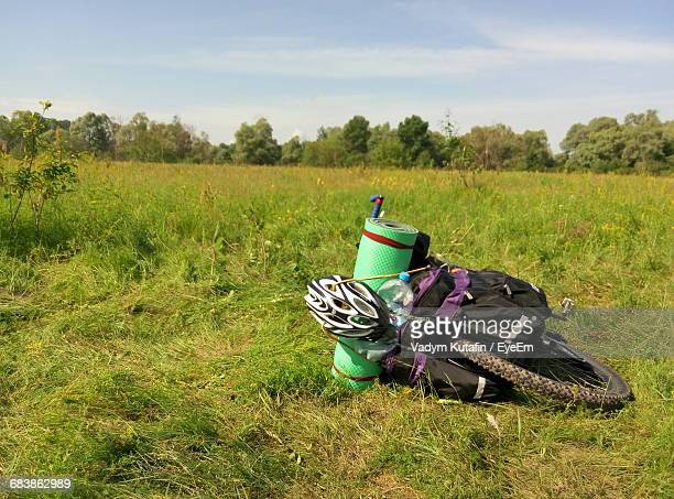 Luggage On Bicycle At Grassy Field Against Sky