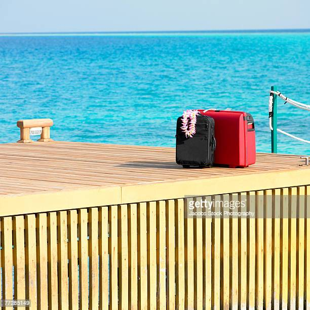 Luggage on pier