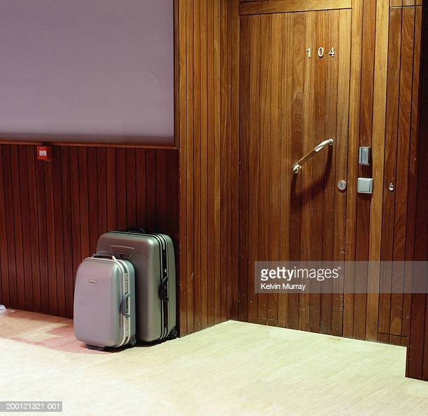 Luggage outside hotel room