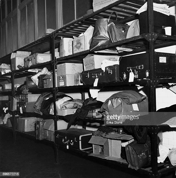 A luggage rack on Ellis Island New York City storing immigrants' suitcases 1950