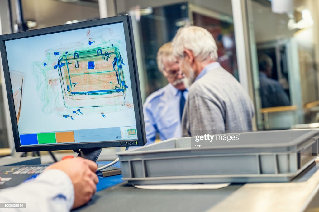 Luggage scanner at the airport : Stock Photo