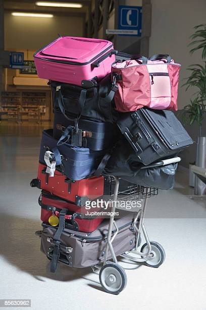 Luggage stacked on luggage cart