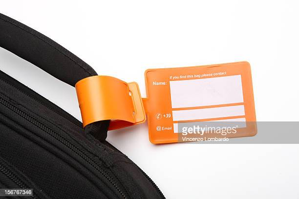 Luggage tag on a bag handle