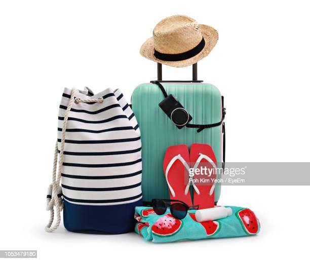 Luggage With Hat And Flip-Flops On White Background