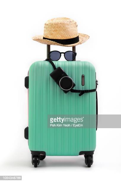 luggage with hat and sunglasses on white background - bag stock pictures, royalty-free photos & images