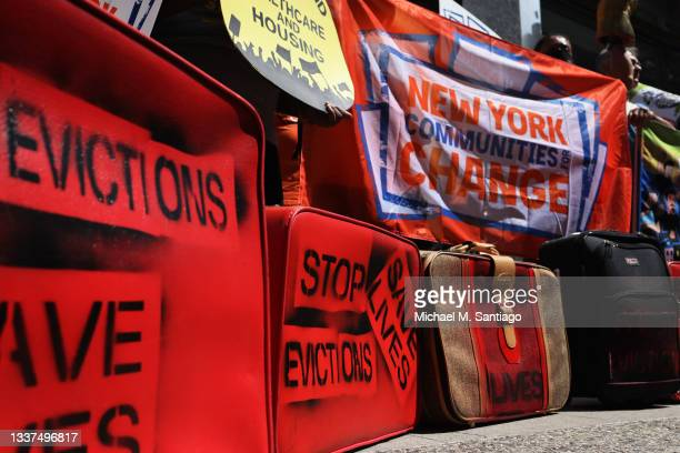 """Luggage with the words """"Stop Evictions Save Lives"""" written on them are seen as people gather outside of a New York City Marshall's office calling for..."""